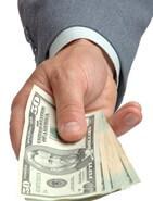 Hand offering dollars
